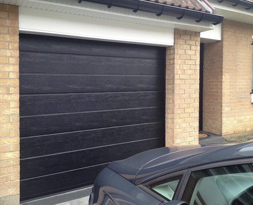Porte de garage mono rainurée bois